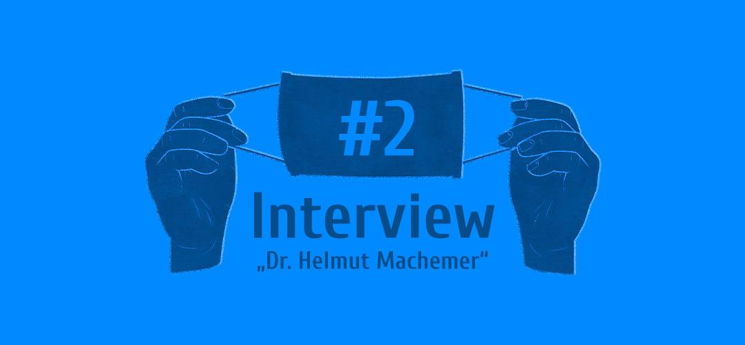 Zwei Hände die eine Maske hoch halten - Interview #2 - Dr. Helmut Machemer