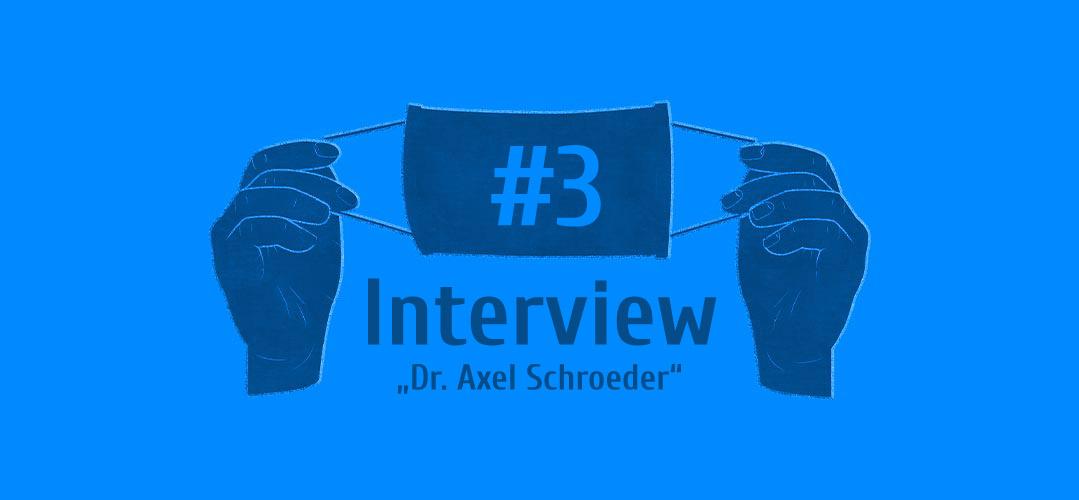 Zwei Hände die eine Maske hoch halten - Interview #3 - Dr. Axel Schroeder