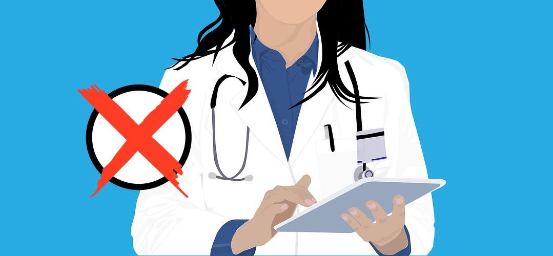 Ärztin mit Kreuz auf Wahlkästchen